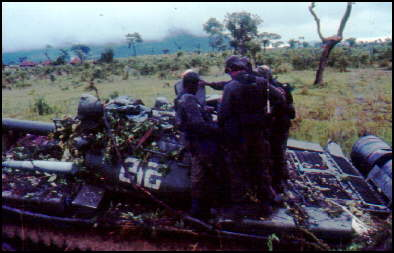 Cubans soldiers over a T-55 in Angola